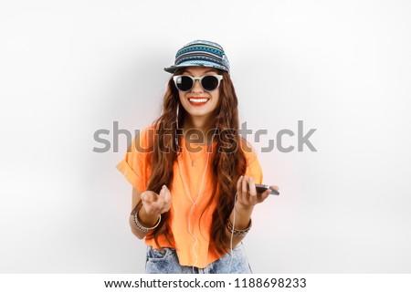 happy brunette woman wearing hat with hands on hips stock photo © wavebreak_media