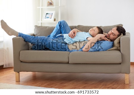father with sleeping son stock photo © is2