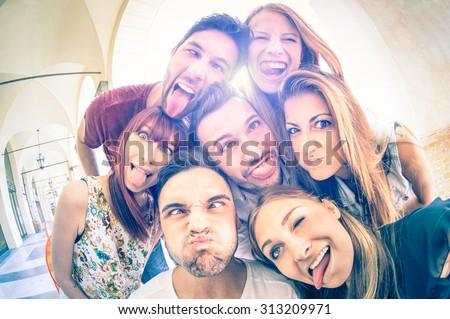 happy teenage students or friends having fun stock photo © dolgachov