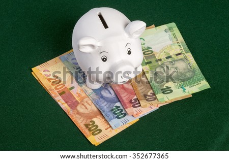 Piggy Bank With Rand Banknotes Stock photo © albund
