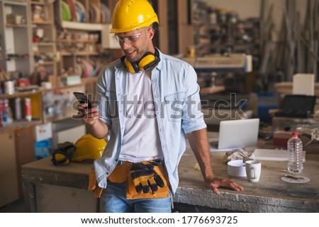 smiling handyman Stock photo © tiero