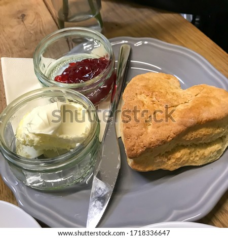 Heart shaped scones with strawberry jam and a cup of tea Stock photo © Melnyk