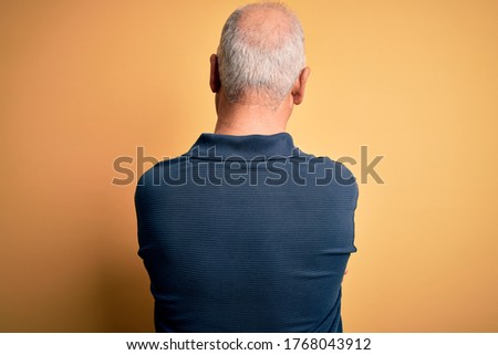 Rear view of senior man with hands behind back standing on the beach Stock photo © wavebreak_media