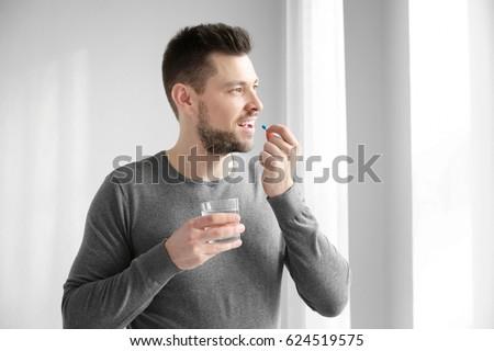 ill man taking a pill Stock photo © nito