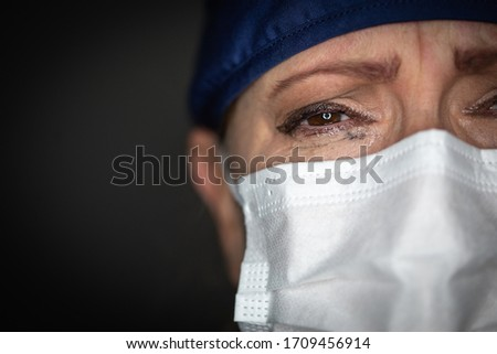 Tearful Stressed Female Doctor or Nurse Wearing Medical Face Mas Stock photo © feverpitch