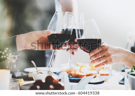 Men and women toasting with red wine in a restaurant Stock photo © Kzenon