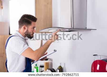 Electrician Repairing Kitchen Extractor Stock photo © AndreyPopov