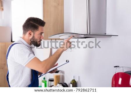 Electrician Repairing Kitchen Extractor Stock photo © AndreyPopov