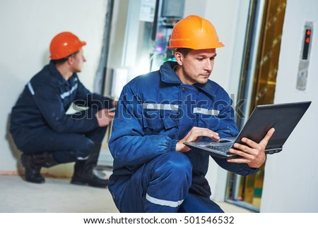 Two electricians testing fuse box Stock photo © photography33