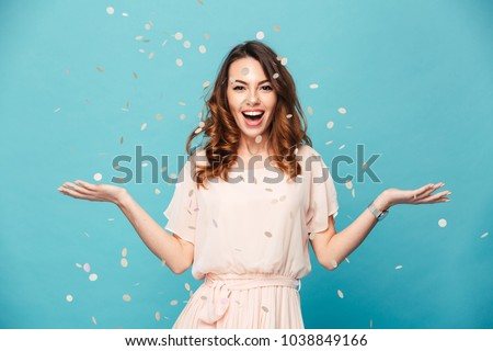Pretty young woman in a blue dress. Isolated stock photo © acidgrey