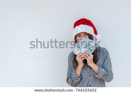 business woman in christmas hat holding american dollars in her stock photo © nejron