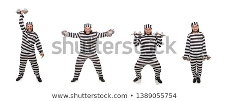 Prison inmate with dumbbells isolated on white Stock photo © Elnur