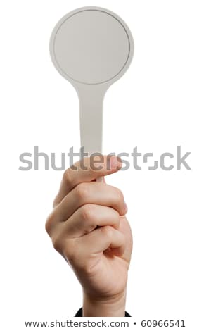 Auction paddle or voting card in hand Stock photo © ia_64