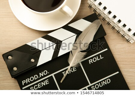 movie clapper, cup of coffee and fountain pen diary top view Stock photo © mizar_21984
