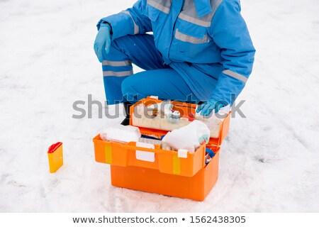Jonge paramedicus werkkleding handschoenen geneeskunde eerste hulp Stockfoto © pressmaster