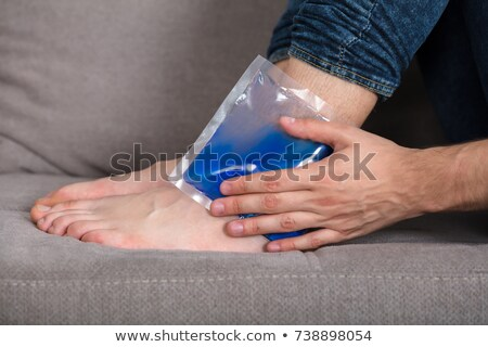 Holding Ice Gel Pack On Ankle Stock photo © AndreyPopov