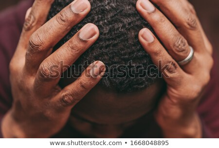unhappy young man suffering from headache Stock photo © dolgachov