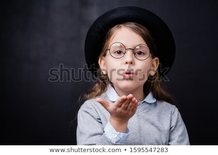 Adorable little girl in smart casualwear and eyeglasses giving you air kiss Stock photo © pressmaster