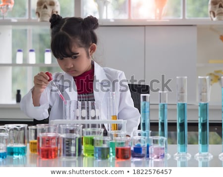 Lány kémcső tanul kémia iskola oktatás Stock fotó © dolgachov