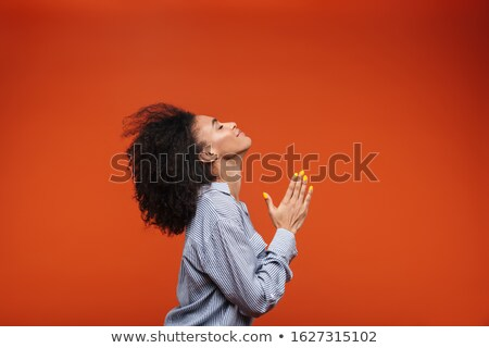 Side view of a young pleading african woman begging Stock photo © deandrobot