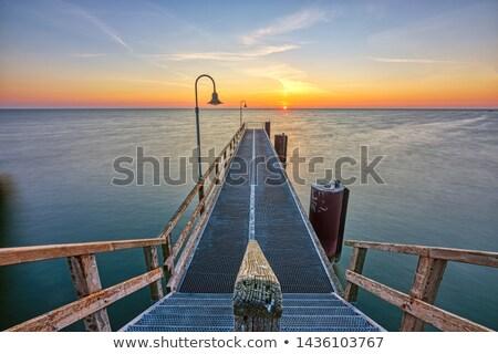 Hosszú móló Balti-tenger part tengerpart égbolt Stock fotó © elxeneize
