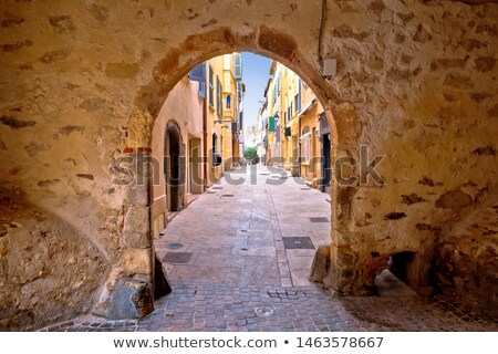 Saint Tropez historic town gate and colorful street view Stock photo © xbrchx
