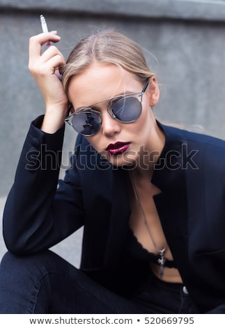 szexi · szőke · fiatal · hölgy · pózol · fekete - stock fotó © konradbak