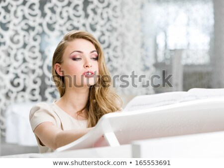pretty blonde woman at the piano stock photo © rcarner