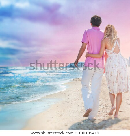 Idealistic poster for advertisement. Couple at the beach holding Stock photo © HASLOO