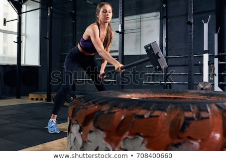 A woman with a sledgehammer. Stock photo © photography33