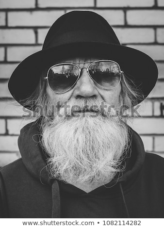 serious aged man with sunglasses looking at camera stock photo © diego_cervo