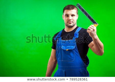 Tradesman holding a try square Stock photo © photography33