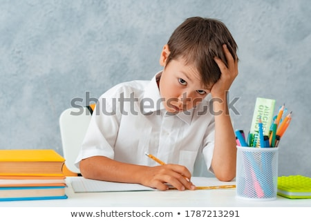 little boy on his school desk Stock photo © photography33