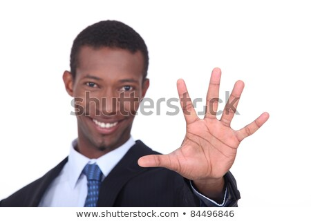 Studio shot of a businessman with the palm of his hand outstretched in front of him Stock photo © photography33