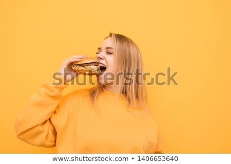 teenage girl eating an hamburger Stock photo © photography33