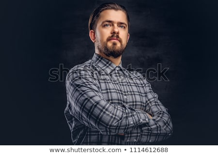Portrait of a dark-haired man with arms crossed Stock photo © photography33