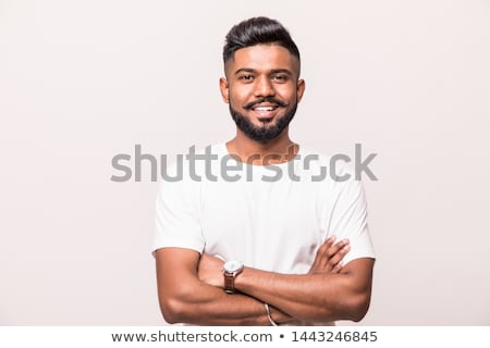 portrait of attractive man smiling with arms folded stock photo © scheriton