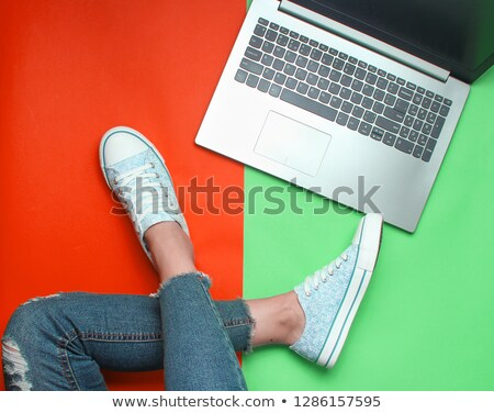 Beautiful female feet and laptop Stock photo © pzaxe
