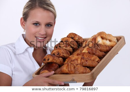 blonde woman holding a platter of croissants Stock photo © photography33
