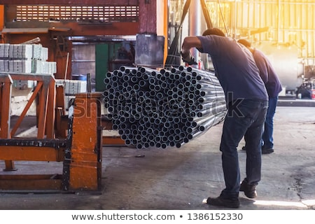 Two men using factory equipment Stock photo © photography33