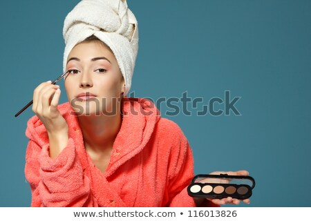 woman in bathrobe putting make up on stock photo © photography33