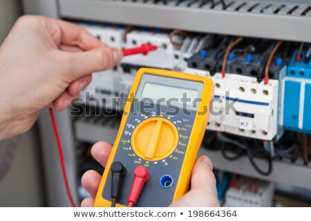 electrician holding multimeter stock photo © photography33