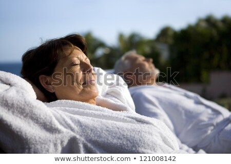 Couple laying outside in bathing robes Stock photo © photography33