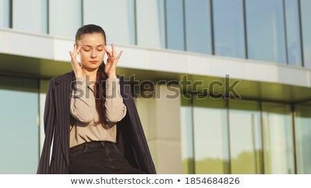 Cansado empresária edifício moderno modelo cabelo corrida Foto stock © konradbak