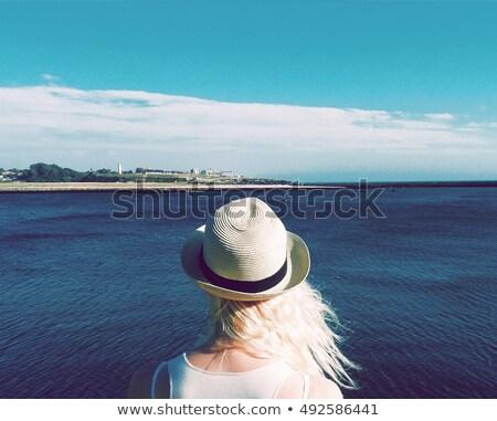 blue hat on a blond girl Stock photo © carlodapino