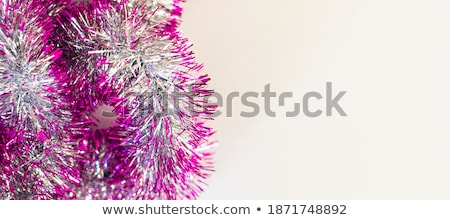 Christmas Gold Tinsel as a border isolated against a white background Stock photo © ozaiachin