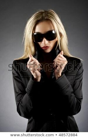 Moça bonita casaco preto perneiras isolado Foto stock © acidgrey