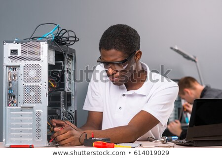 Man fixing a hard drive Stock photo © photography33