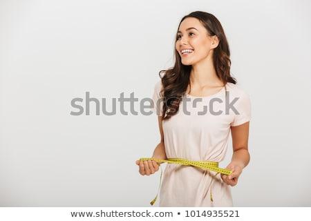 Nő mér derék mérőszalag izolált fehér Stock fotó © Nobilior