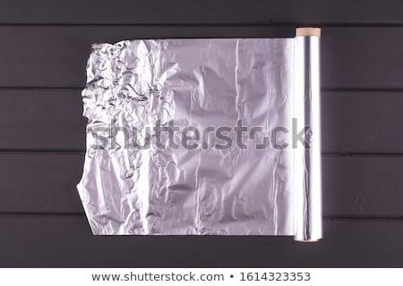 Abstract crumpled silver aluminum foil closeup background textur Stock photo © arcoss